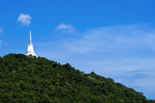 white stupa on mountain