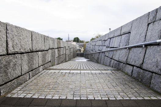 wall of rough granite blocks
