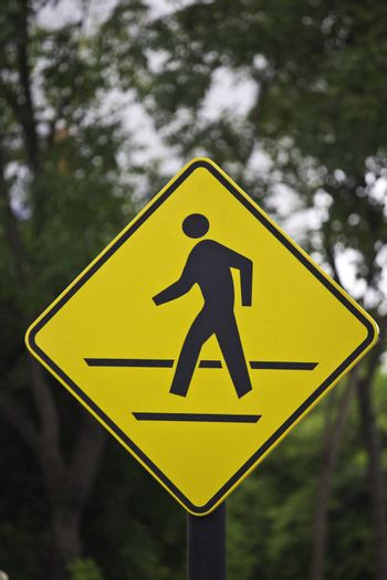 walking sign in the yellow background