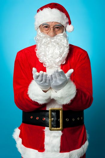 Santa praying peace and happiness for all