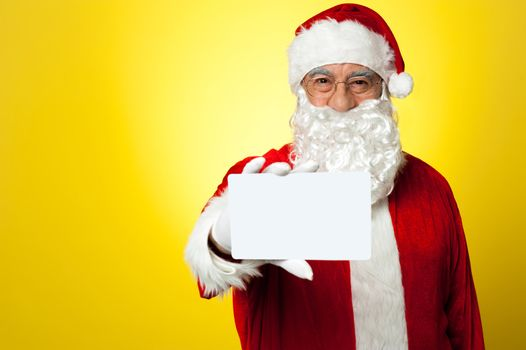 Santa holding blank white placard