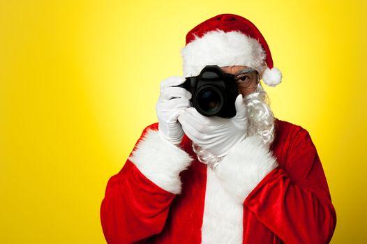 Say cheese! Santa capturing a perfect moment