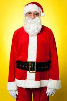 Isolated aged male dresses in Santa attire