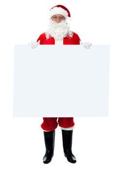 Saint Nicholas standing behind blank whiteboard