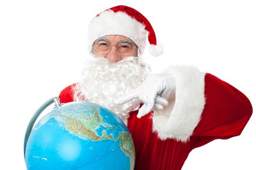 Expressionistic Santa pointing at north pole on globe
