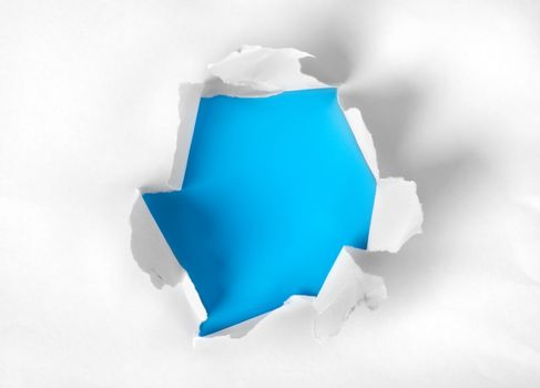 Paper torn with blue background