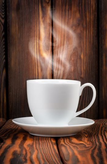 White cup with steaming hot drink