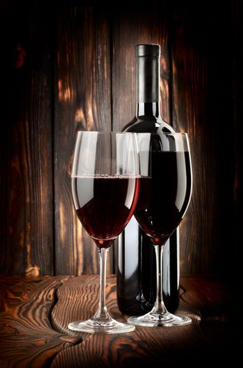 Two glasses of wine and wine bottle