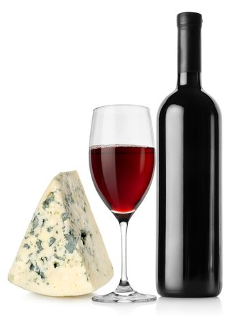 Wine bottle, wineglass and cheese
