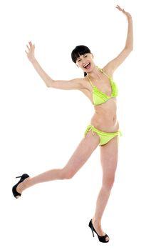 Joyous woman in green lingerie dancing in joy