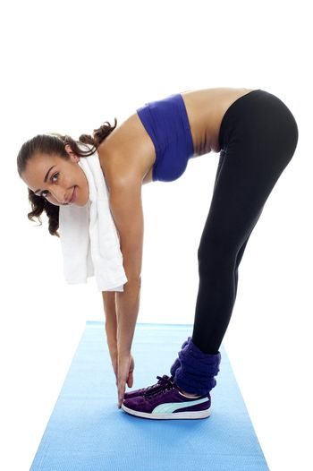 Fit woman bending over and touching her toes