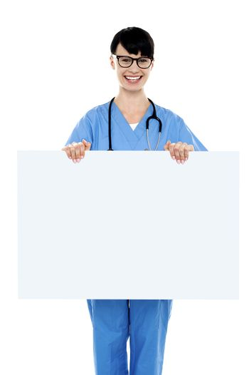 Medical practitioner holding blank ad board