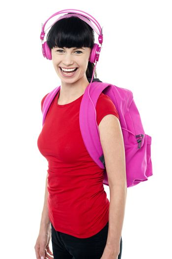 Student enjoying music on her way to college