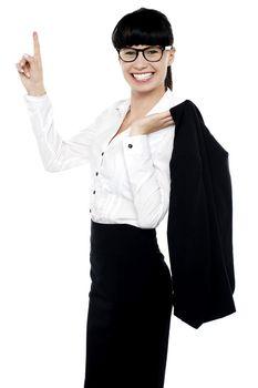 Lively female entrepreneur pointing upwards
