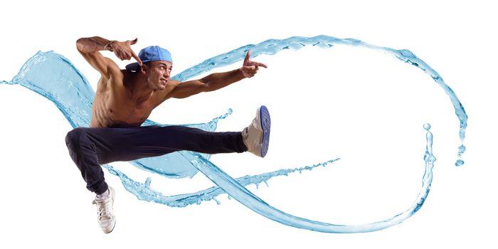 Dancer jumping on the background color splashes