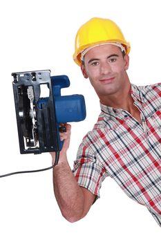 Carpenter displaying his new circular saw