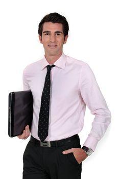 Businessman carrying laptop underarm