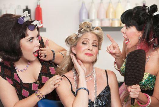Trio of pretty Caucasian women showing off in hair salon