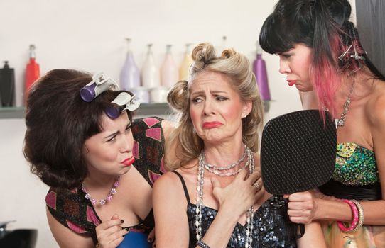 Sad white females in hair salon with mirror