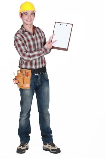full-length portrait of young craftsman holding clipboard