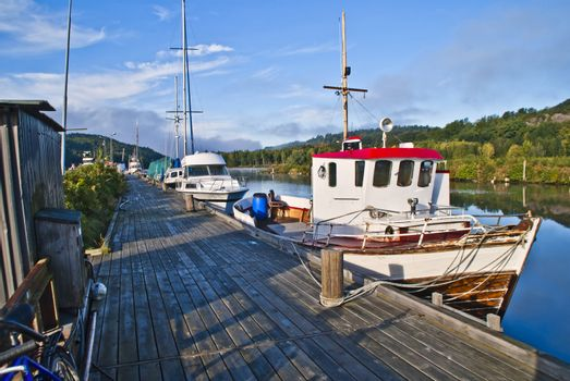 sjark boat is a type of light fishing and shuttle boat with room for a single fisherman and is common along the coast of norway, but it is mostly coastal fishermen with sjark in northern norway, the boat is moored to the pier in tista river in halden.