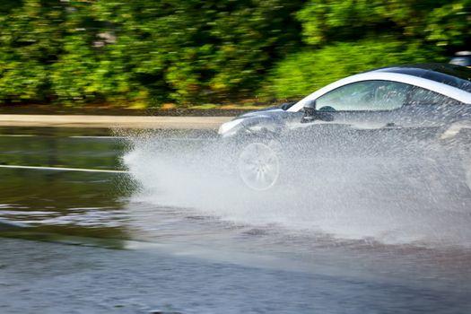 Car moving through puddle