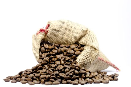 coffee beans in a burlap bag on white background