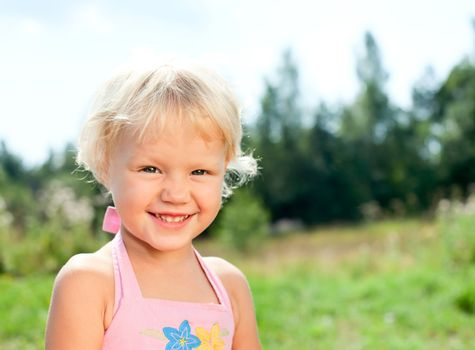Blonde girl outdoors