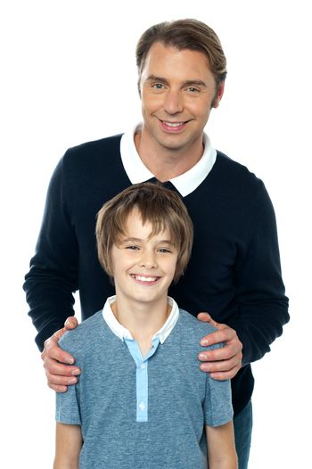 Man in blue pullover posing with his son