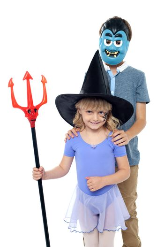 Cute little devils dressed in halloween costumes
