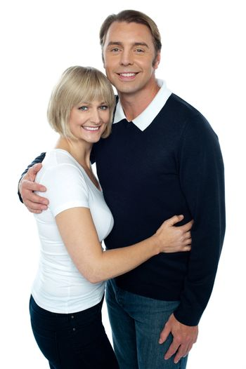 Stylish man in pullover embracing his blonde wife