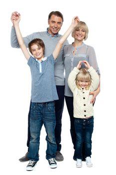 Playful kids with parents. Family portrait