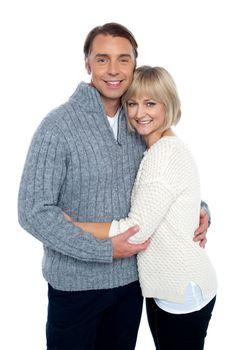 Fashionable woman hugging her loving husband