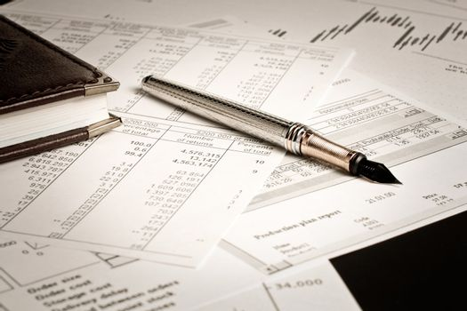 Making of a financial plan using notebook pen and various charts