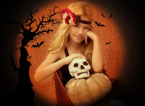 halloween kid girl with pumpkin and skull smiling