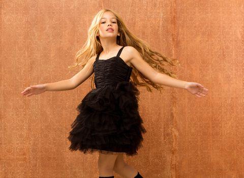 black dress kid girl dancing and twisting vintage