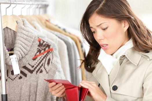 Empty purse or wallet - no money for shopping concept