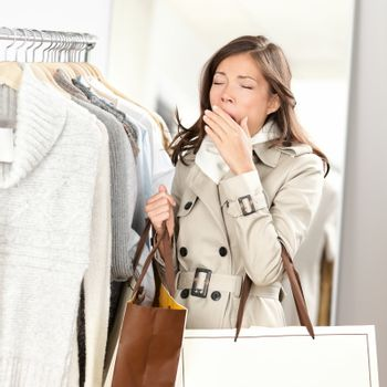 Tired woman yawning shopping clothes