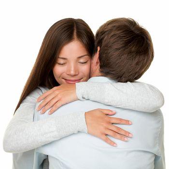 Embracing couple hugging happy