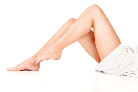 female legs and towel