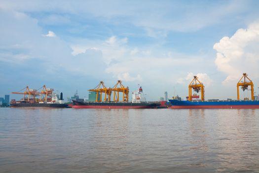 Industrial shipping port at day in Bangkok, Thailand