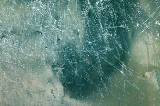Image of green glass texture close-up with scratches over surface.Texture for desighner.