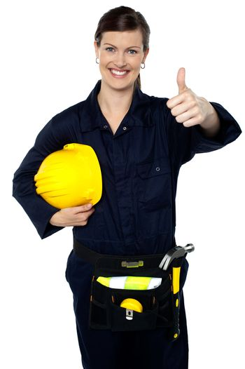 Woman in builder uniform showing thumbs up