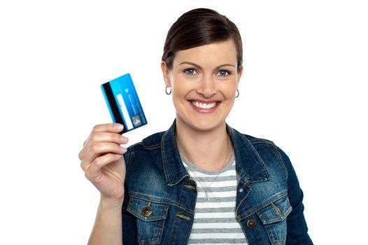 Shopaholic woman showing cash card