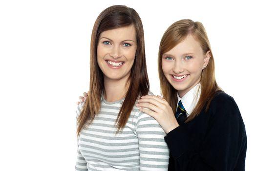 Daughter resting hands on mothers shoulders