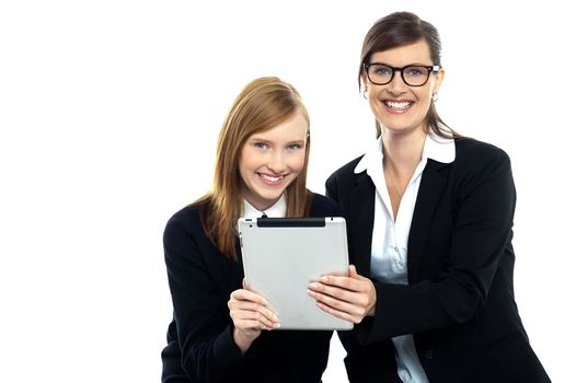 Tutor with student holding portable tablet pc