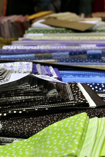 Big assortment of fabrics in the textile store