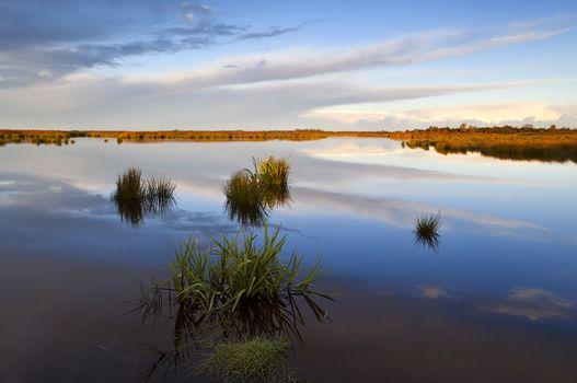 reflections on lake after sunrise