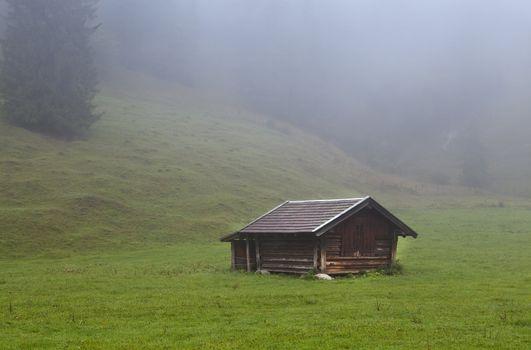 wooden hut on alpine meadows