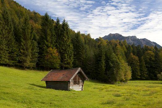 wooden alpine hut in autumn